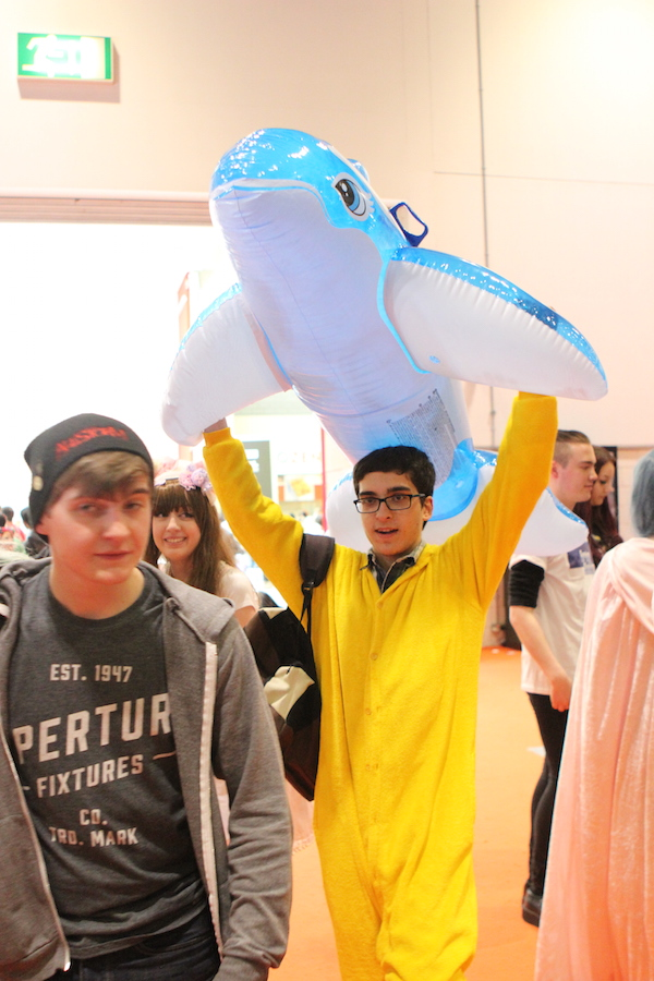 Man carrying an inflatable shark